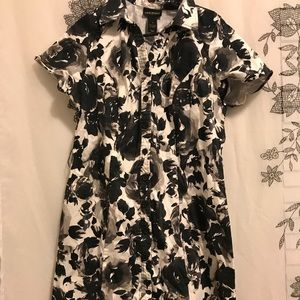 Floral dress. So cute and flatters body well.